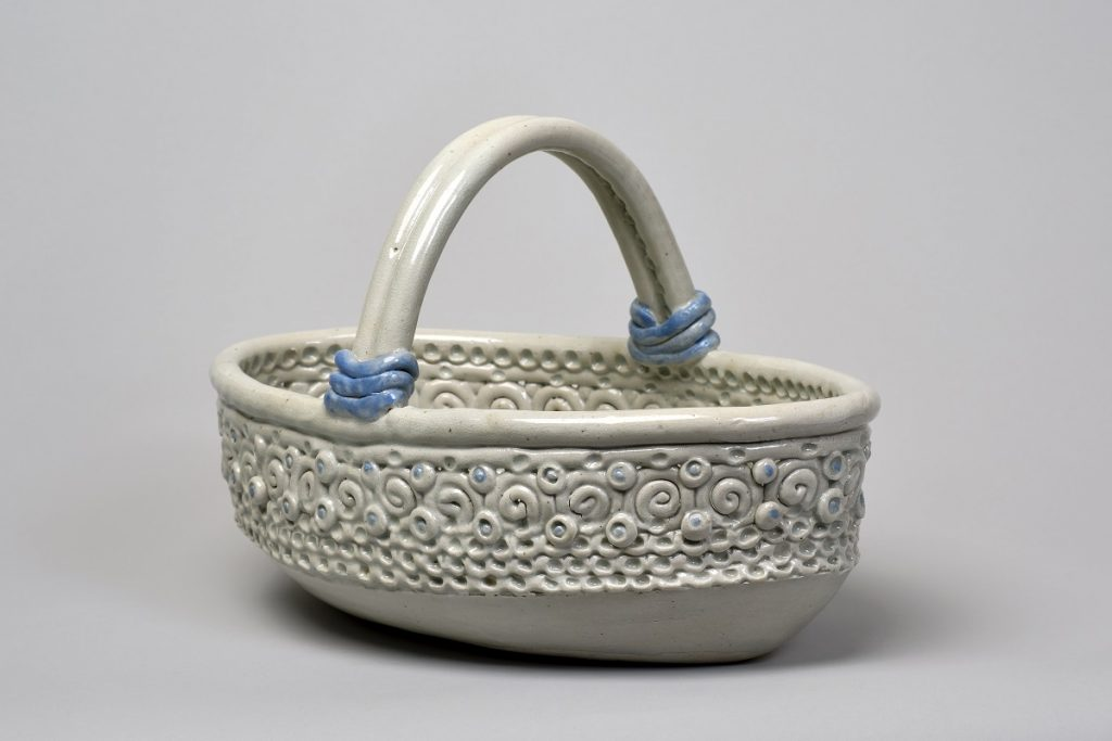 Image of a white ceramic basket-like bowl with blue accents.