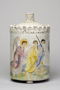 Scene from the Resurrection of Lazarus painted on the side of a ceramic lidded vessel, with 2 people and an angel