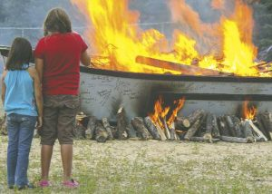 august_2012eaglefeather-news-symbolic-burn-of-canoe-for-healing-from-res1
