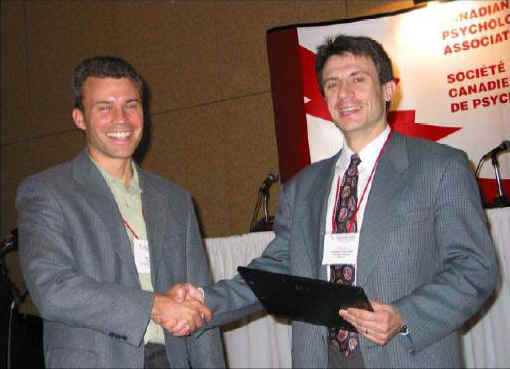 Dr. Dozois congratulates Dr. Hadjistavropoulos at the CPA Convection in St. John's Newfoundland (2004)